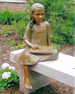 "Photo of sculpture piece ""Every Child is an Artist"""