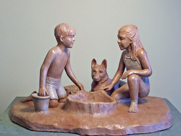 Photo of a sculpture of young boy and girl and a dog